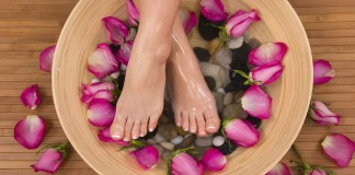 sexy painfree feet in bowl of rose petals